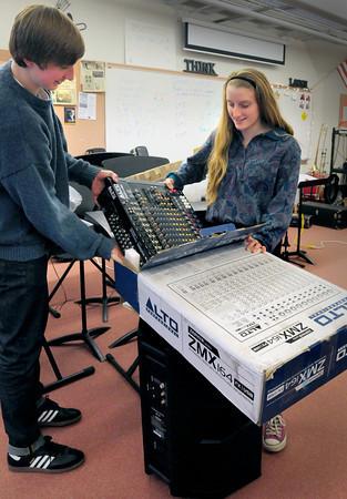 Newburyport: Newburyport High students Matt Daniels, 17, and Meghan Healey, 17, unpack a new PA system in the band room. Bryan Eaton/Staff Photo