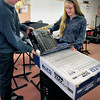 Newburyport: Newburyport High students Matt Daniels, 17, and Meghan Healey, 17, unpack a new PA system in the band room. Bryan Eaton/Staff Photo