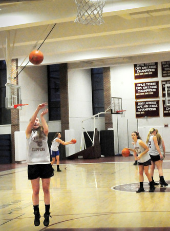 Newburyport: Newburyport High girls basketball team practice jump shots last night. Bryan Eaton/Staff Photo