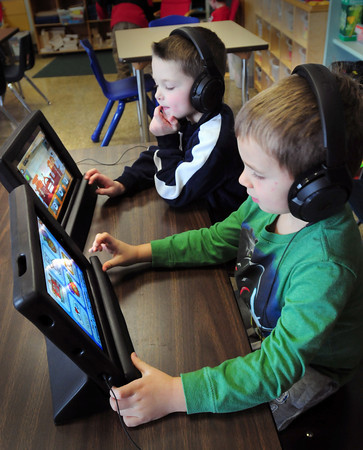 Newburyport: Briggs Lauranzana, back, and Ben Misner, both 5, work on some sight word games on Ipads in Linda Gershuny's class at the Brown School in Newburyport. The Newburyport Education Foundation purchased two of the items for each kindergarten class. Bryan Eaton/Staff Photo
