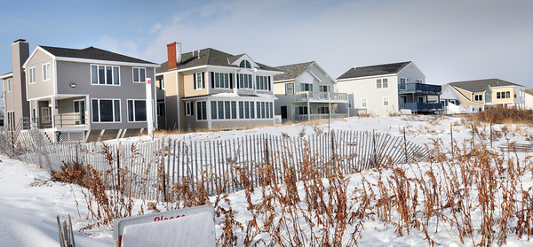 Salisbury: Some newer homes have been built on the northern end of Salisbury Beach, here on Commonwealth Avenue, and quite a safe distance from the crashing waves that have wreaked havoc on some beaches as far south to Plum Island. Bryan Eaton/Staff Photo