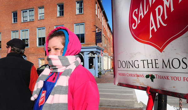 Newburyport: Salvation Army volunteer Kasey Jeanson of Newburyport braved yesterday's cold and wind ringing the bell at the corner of Pleasant and State Streets in Newburyport. Cold weather continues into the weekend with a forecast of snow with some forecasters saying up to six inches possible. Bryan Eaton/Staff Photo