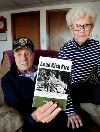 "Newbury: Gene Palumbo, with wife, Jeanie, wrote a book on World War II called ""Load Kick Fire."" Bryan Eaton/Staff Photo"
