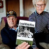 "Newbury: Gene Palumbo, with wife, Jeanie, wrote a book on World War II called ""Load Kick Fire."" Bryan Eaton/Staff Photo"
