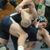 Byfield: Triton wrestler John Boyle in action against Peabody. Bryan Eaton/Staff Photo
