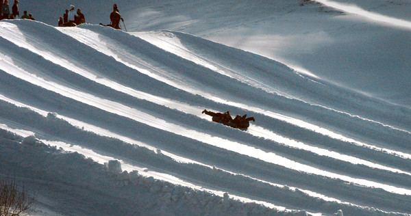 Amesbury: Tubers head down the hill at Amesbury Sports Park yesterday afternoon. The facility is getting help from nature as cold temperatures and snow are in the forecast for Thursday and Friday. Bryan Eaton/Staff Photo