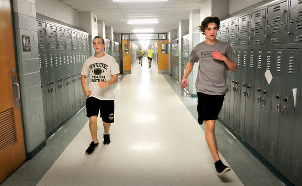 West Newbury: Members of the new Pentucket boys indoor track program run sprints along the hallways of the Pentucket Middle School. Bryan Eaton/Staff Photo