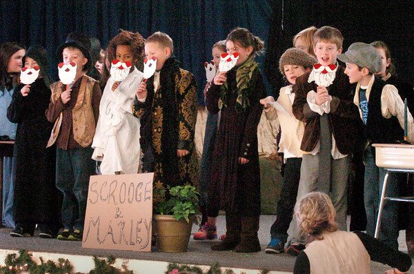 """Amesbury: Amesbury Elementary School teacher Suzanne Morin directed   the play """"A Christmas Carol"""" for students and parents to see on Thursday. At the closing the students donned Santa Claus masks and sang """"We Wish You a Merry Christmas."""" Bryan Eaton/Staff Photo"""