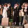 "Amesbury: Amesbury Elementary School teacher Suzanne Morin directed   the play ""A Christmas Carol"" for students and parents to see on Thursday. At the closing the students donned Santa Claus masks and sang ""We Wish You a Merry Christmas."" Bryan Eaton/Staff Photo"