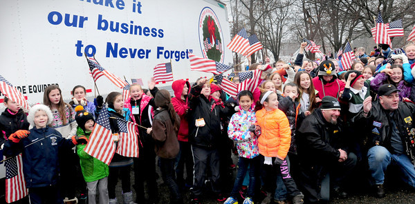 Rowley: Students from the Pine Grove School posed with escorts of the Wreaths Across America convoy as they stopped at the school on their way to Arlington National Cemetery to be laid at the graves of veterans. The stops on the way from Worcester Wreath Company in Maine aims to remember, honor and teach students about those who gave their lives for the country. Bryan Eaton/Staff photo