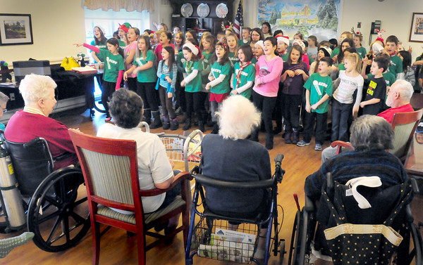 """Amesbury: The Cashman School Chorus start out their concert with """"Boogie Woogie Reindeer: Do You Know Blitzer?"""" as they performed for residents of Amesbury Village on Wednesday afternoon. Bryan Eaton/Staff Photo"""