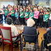"Amesbury: The Cashman School Chorus start out their concert with ""Boogie Woogie Reindeer: Do You Know Blitzer?"" as they performed for residents of Amesbury Village on Wednesday afternoon. Bryan Eaton/Staff Photo"