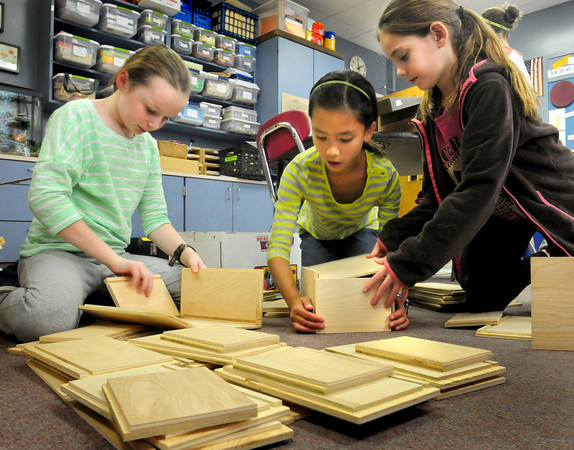 """Rowley: Pine Grove School students assemble """"sproutlet boxes"""" in which to store """"attribute tools."""" From left, Sydney Marsh, 10, Kate Trojan and Lindsay Machado, both 9. Bryan Eaton/Staff Photo"""