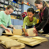 "Rowley: Pine Grove School students assemble ""sproutlet boxes"" in which to store ""attribute tools."" From left, Sydney Marsh, 10, Kate Trojan and Lindsay Machado, both 9. Bryan Eaton/Staff Photo"