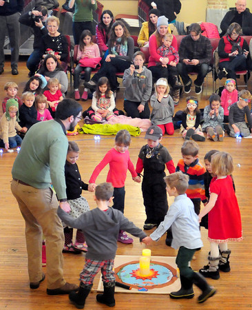 Newburyport: The Newburyport and Inn Street Montessori Schools celebrated their annual Peace Gathering upstairs at Newburyport City Hall on Wednesday. Here the kindergartners take their turn singing while dancing around candles. Bryan Eaton/Staff Photo