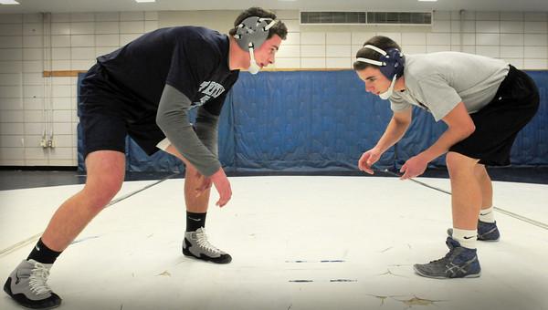 Byfield: Triton wrestlers Mark, left, and Luke Boyle. Bryan Eaton/Staff Photo