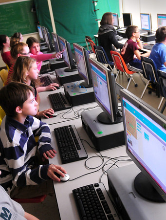 """Newburyport: Students at the Molin Upper Elementary School in Newburyport work on their """"Hour of Code"""" a one-hour introduction to computer science, designed to demystify """"code"""" and show that anyone can learn the basics to be a maker, a creator, an innovator. Steve Jobs stated, """"""""Everybody in this country should learn how to program a computer because it teaches you how to think."""" Bryan Eaton/Staff Photo"""