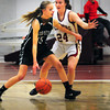 Newburyport: Manchester Essex player Fraley Morton gets covered by Newburyport's Lilly Donovan. Bryan Eaton/Staff Photo