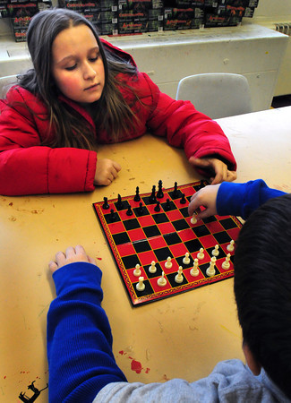 Salisbury: Kailey Tidd, 10, of Salisbury watches as Jonathan Zinck, 8, of Newburyport makes his move in chess at the Boys and Girls Club in Salisbury on Thursday afternoon. The chess set was one of the gifts Jonathan received for Christmas. Bryan Eaton/Staff Photo