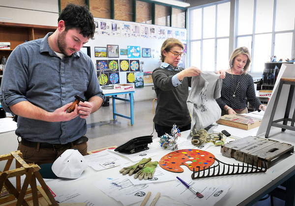 West Newbury: The Pentucket Arts Foundation is working on a big public art project wrapping up this May. The mixed media artist, Sean Bixby, left, meeting with organizers to look at all of the items donated so far and taking photos of them for the viewbook. Bixby, left, who is also an art teacher at Pentucket High School with foundation members Sue Stasiuk, center, and Diane Doyle. Bryan Eaton/Staff Photo