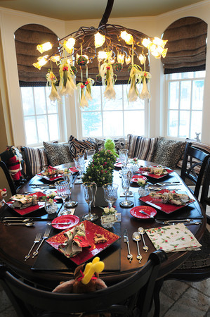 Newburyport: Place settings in the kitchen of Jeanne Petrillo have Christmas character themes as Rudolph the Red-Nosed Reindeer and Frosty the Snowman. Bryan Eaton/Staff Photo