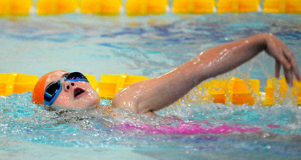 haverhill: Emmerson Cerasoulo, 7, competes in the 100 meter swim at the 3rd annual Michael J. Horgan Memorial Swim Meet at Haverhill High School Pool  Staurday afternoon. teams competed in different lenth races to raise money for the Michael J. Horgan Memorial Fund in honor of Michael Horgan who died in March of 2011. Jim Vaiknoras/staff photo