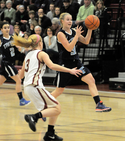 newburyport: Triton's Erin Savage leads a fast break during their game against Newburyport in the 10th annual Institution for Saving Holiday Basketball tournament Friday night at Newburyport high. JIm Vaiknoras/staff photo