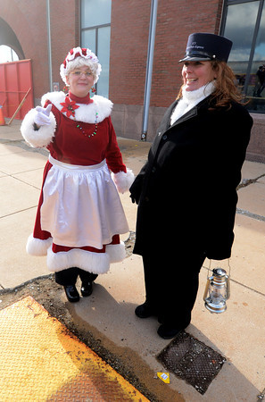 Newburyport: Jen Troisi as Mrs Claus and Platform Manager Kirsten Dumaresq wait for the return of the Polar Express during the annual Immaculate Conception School Fundraiser at the Newburyport Train Station Saturday. JIm Vaiknoras/staff photo
