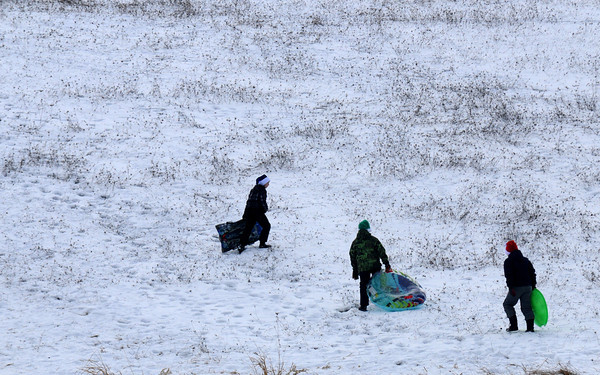 Amesbury: Three sledders make their way back up the hill at Woodson Farm Saturday afternoon. Jim Vaiknoras/staff photo