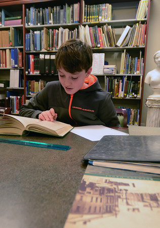 Newburyport: Alex Kelleher a student at the Nock Middle School does research for a report he is doing on the Swett House at the Archive Center at the Newburyport Library.  JIm Vaiknoras/staff photo