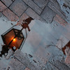 Newburyport: A street light is reflected in a puddle of melted snow on Inn Street in Newburyport. JIm Vaiknoras/staff photo