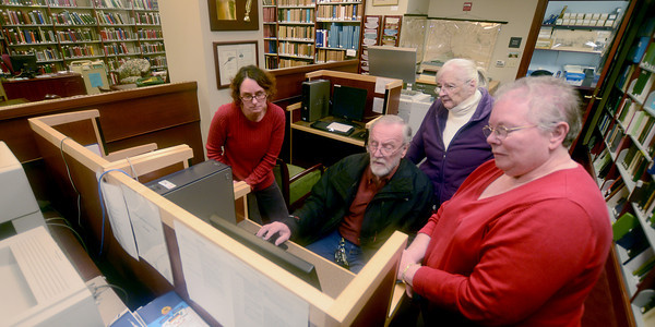 Newburyport: Sharon Spieldenner, Mike Bulger, Cecile Pimental, and Linda Tully use one of the computers to research old photographs at the Archive Center at the Newburyport Library.  JIm Vaiknoras/staff photo