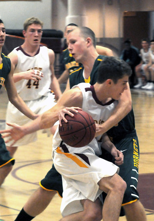 Newburyport: Newburyport's Michael Shay is fouled during the Clippers game at home against North Reading Friday night. Jim Vaiknoras/staff photo