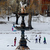 Newburyport: Skaters, sledders, and a kid on his cell phone enjoy an ice and snow covered Bartlet Mall in Newburyport Friday, jim vaiknoras/staff photo