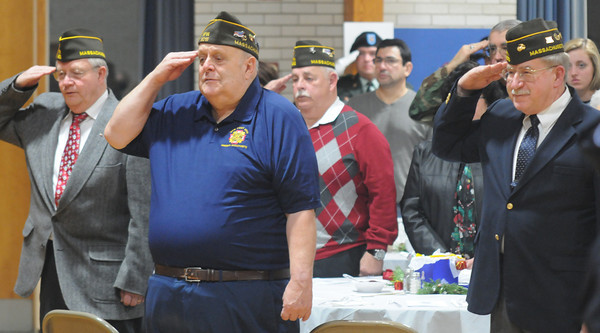 Amesbury: Veterans salute during the National Anthem at the 12th annual Support the Troops Christmas Dinner and reception at Holy Parish Hall in Amesbury. Jim Vaiknoras/staff photo