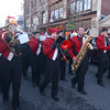 Amesbury: The Amesbury hhigh school marching band makes it's way down Main Street in the Amesbury Santa Parade Saturday. Jim Vaiknoras/staff photo