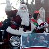 Amesbury: Santa waves as he makes his way down Main Street in the Amesbury Santa Parade Saturday. Jim Vaiknoras/staff photo