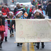 Merrimac: Girl Scout troop 75174 from Groveland marches up West Main Street during the town's annual Santa Parade Sunday. Jim Vaiknoras/staff photo