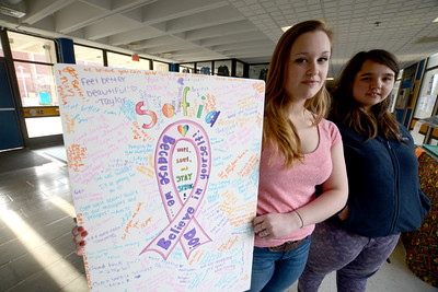 Byfield:Triton students Rose Gaffin and Katelyn Pritchard hold a card they made  for a little girl with cancer, . Jim Vaiknoras/staff photo