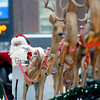 Merrimac: Santa and his reindeer wave as they pass by the crowd on West Main Street during the town's annual Santa Parade Sunday. Jim Vaiknoras/staff photo