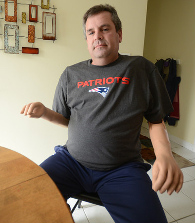 Merrimac: James Young of Merrimac, who lost both arms in an electrical accident, shows his new arms which he controls with nerve impulses. Jim Vaiknoras/staff photo