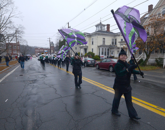 Merrimac: The Pentucket High Color Guard twirls their flags on West Main Street in Merrimac during the town's annual Santa Parade Sunday. Jim Vaiknoras/staff photo