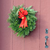 Newbury: A green wreath with a red ribbon on a red door. Jim Vaiknoras/staff photo