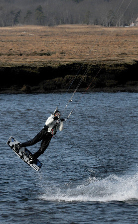 Salisbury: Jay Oczkowski of Seabrook catches some air as he kite surfs near the Salisbury Reservation boat dock Saturday. Jim Vaiknoras/staff photo