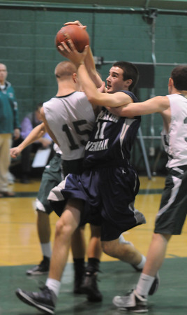 West Newbury: Pentucket's Ryan Kuchar is guarded by Henry Eagar and Nico Serpa during the Sachems game against Hamilton-Wenham Monday night. Jim Vaiknoras/staff photo