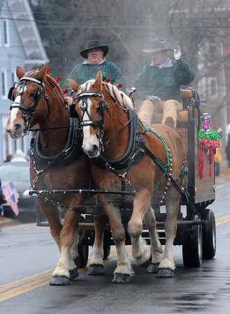 Merrimac: Steam rises from a tea,m of horses from Twin Cedar Farm as they make their way up  West Main Street during the town's annual Santa Parade Sunday. Jim Vaiknoras/staff photo