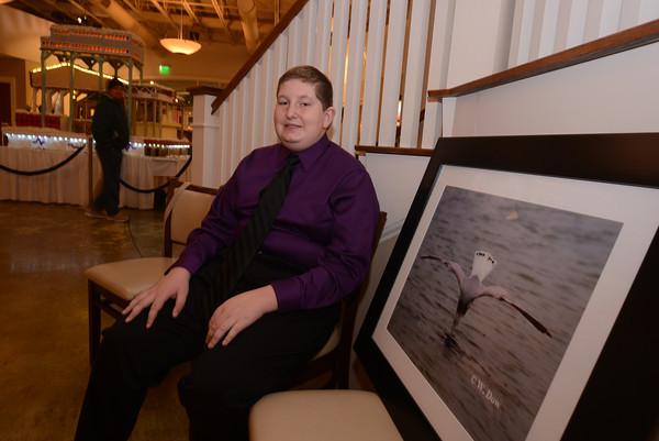 Salisbury: William Dow poses with his award winning photograph at Seaglass in Salisbury. Jim Vaiknoras/staff photo