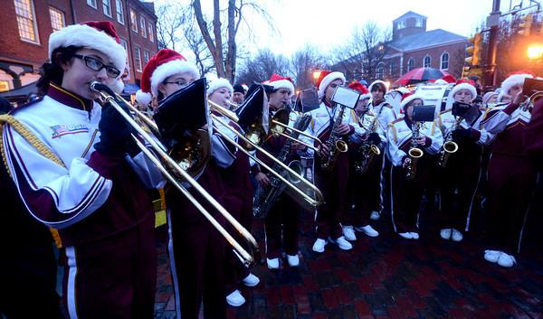 newburyport: The Newburyport  high band performs at the annual tree lighting in Market Square in Newburyport Sunday. jim Vaiknoras/staff photo