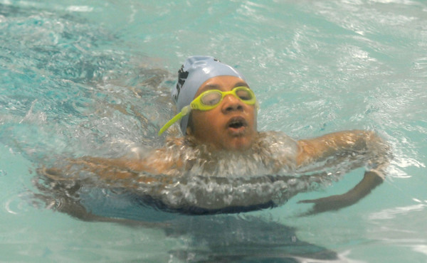 Newburyport: Triton's Kayla Pearson competes in ther individual medley during the Viking met against Manchester at the Newburyport YMCA. JIm Vaiknoras