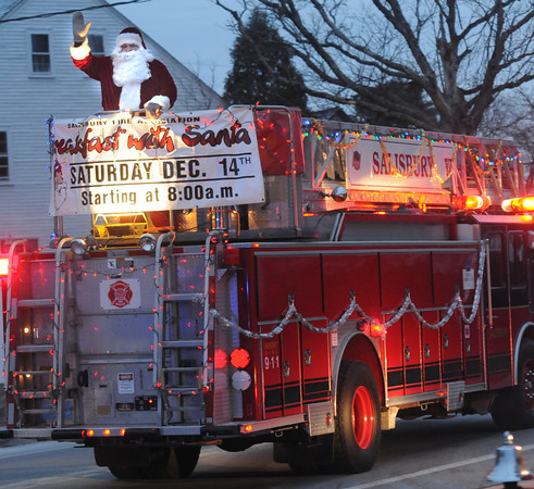 Salisbury: Santa waves from the back of a Salisbury Firetruck Sunday night on the fire dept annual ride through town. Jim Vaiknoras/staff photo
